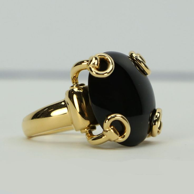 Gucci Onyx Gold Stirrup Ring   From a unique collection of vintage more rings at https://www.1stdibs.com/jewelry/rings/more-rings/