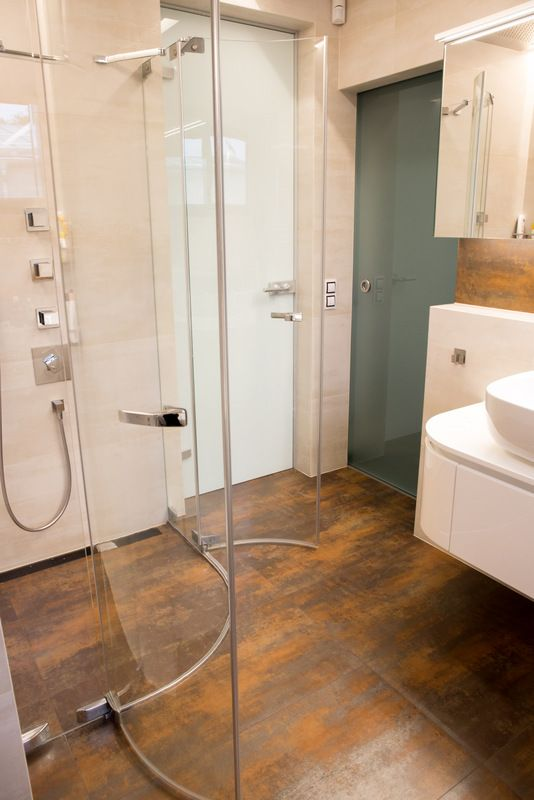 Glass doors in family bathroom. making space more airy.