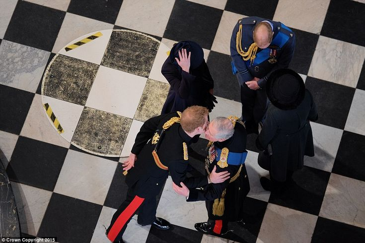 Warm welcome: Prince Harry gives his father a kiss as he arrives, while the Duke of Cambri...