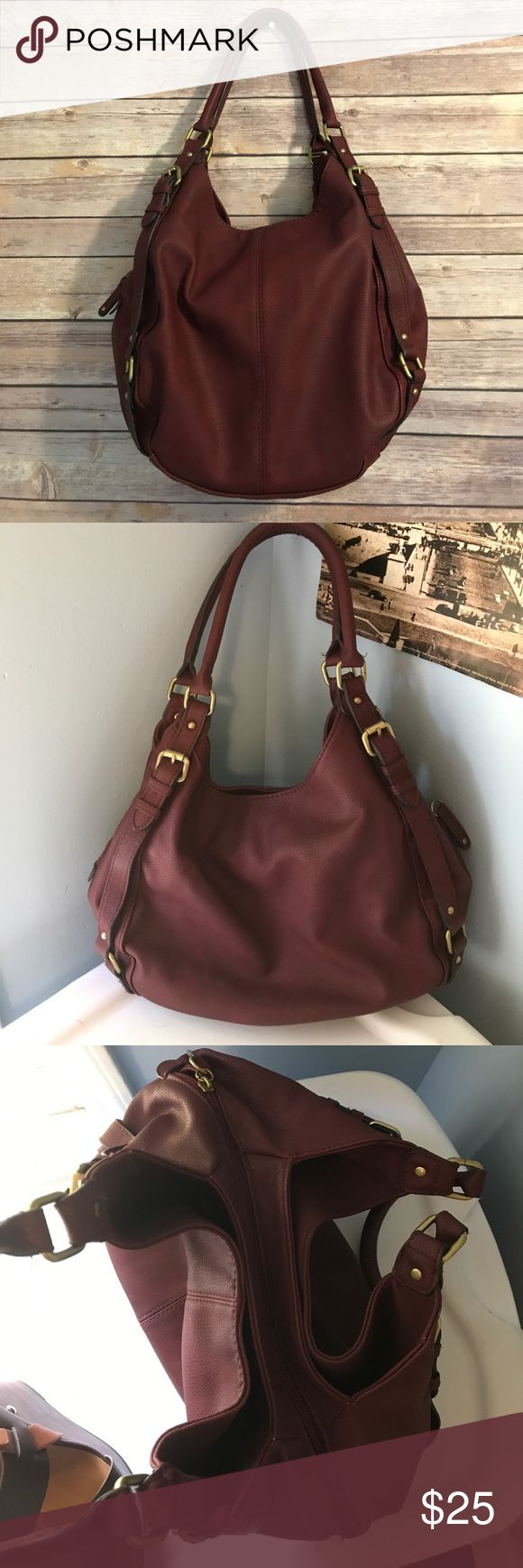 Burgundy faux leather shoulder bag gold hardware Burgundy faux leather shoulder bag gold hardware. Me Rona from Target. Center zip compartment has 2 slip/media pockets and 1 zip. 2 snap compartments on either side. Gold hardware. Thick rounded straps secured with hardware. New without tags. Brand new condition with no marks tears etc. Merona Bags