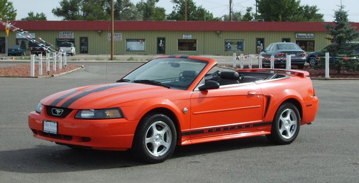 I usually don't like the color orange, but I would make an exception.  I love the ford mustang:)