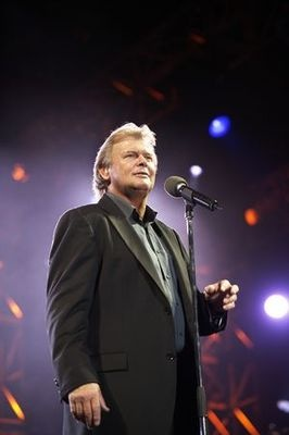 """John Peter Farnham AO (1 July 1949), English born Australian singer. His career has mostly been as a solo artist (he briefly replaced Glenn Shorrock as lead singer of Little River Band during 1982–1985. In Sept 1986 his solo single, """"You're the Voice"""" peaked at No. 1 on the Australian singles charts. """"Whispering Jack"""" held the #1 for 25 weeks, and is the highest-selling album in Australian history. Both single and the album had Top Ten success internationally including #1 in Sweden."""