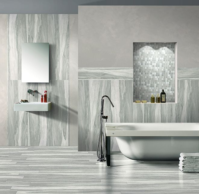 Seasons Winter- carving out a small area for bathtub could create a shelf for shower on other side