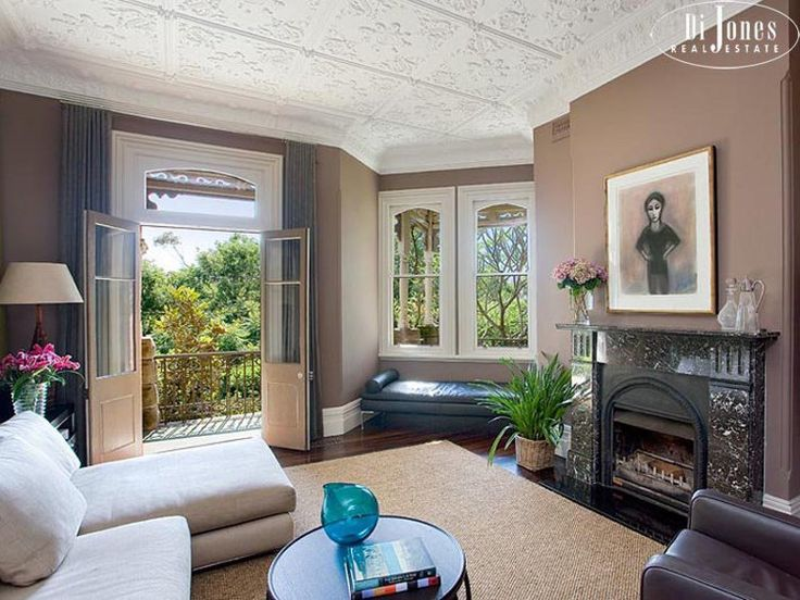 Love everything about this room except the painting over mantle.  Sad.