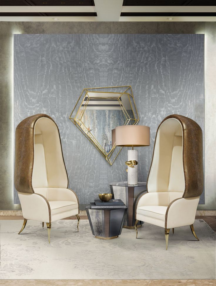 As a tribute to Dorothy Draper's high style we took the classic Drapesse chair and added a bit of KOKET lavish & sensuous edge. Complete with lux velvet and metallic cream leather, finished with polished brass feet.