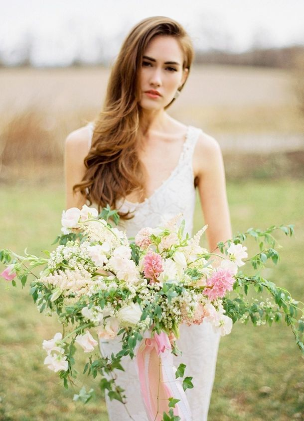 20 Long & Loose Wedding Hairstyles | SouthBound Bride | http://www.southboundbride.com/wedding-hair-inspiration-long-loose | Credit: Jodi Miller Photography via Style Me Pretty