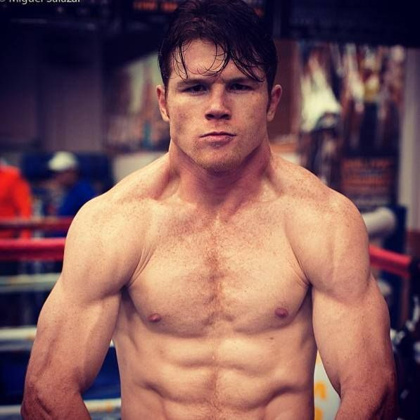 Canelo Alvarez flexing his Mexican, red headed, freckled hotness...YES!!! :)