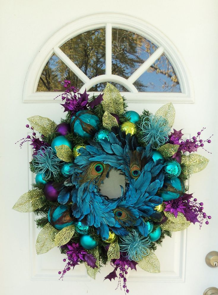 Peacock Christmas Wreath. $169.00, via Etsy. I couldn't afford this /: but its absolutely beautiful I think!!!! Love peacock colors. ...