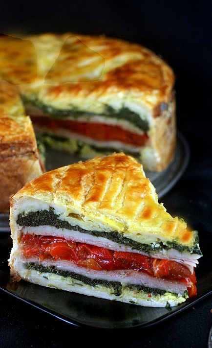 Tourte Milanese - layers of herbed scrambled eggs, ham or turkey, garlic spinach, swiss cheese and roasted red peppers encased in puff pastry. A great brunch stunner and easy!