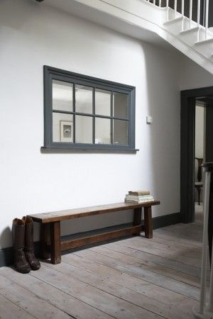 interior window and a dark wood bench