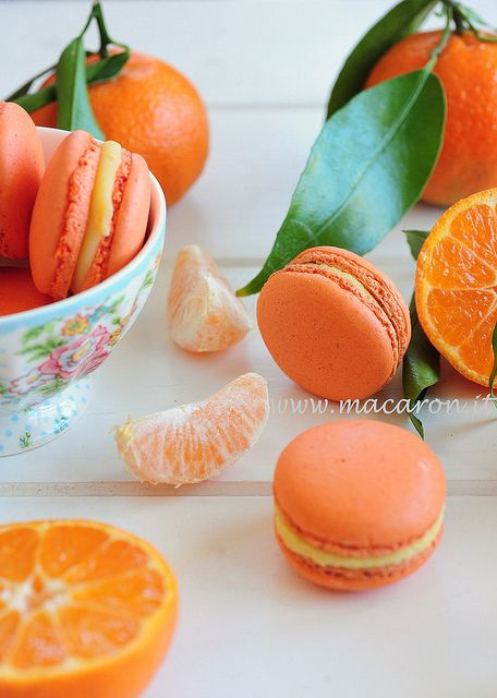 How amazing do these look? I love Macaroons! Tangerine macaroons by Croissant  Parmesan, via Flickr