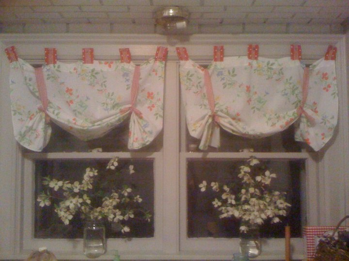 simple swag curtains I made out of old bed sheets i got at the thrift store. SO easy!