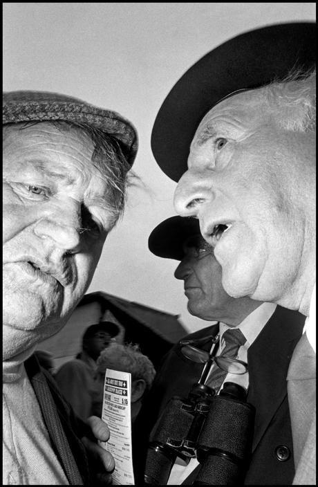 Magnum Photos Photographer Portfolio - Bruce Gilden 1996. Men at a racetrack.