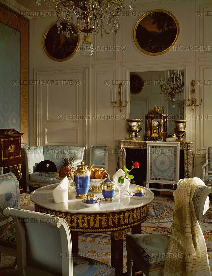 "PERIOD:EMPIRE INTERIORS:ALL 19TH The breakfast room of Emperor Napoleon I Bonaparte and Empress Marie-Louise in the Trianon in Versailles. The table is laid with the Empire style Tea-set ""Vieux-Paris"",property of the Emperor. One of his hats on the couch in the background. Grand Trianon, Versailles, France"