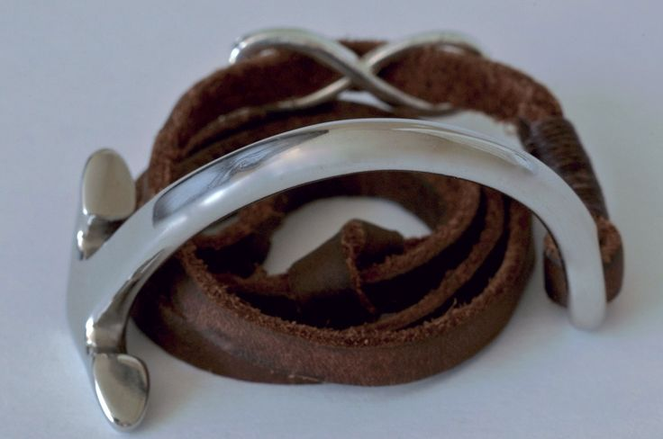 The Immobile: A bold silver stainless steel half anchor with a matching infinity charm, bound with 6mm brown leather lace that adjusts to any wrist.(Immobile- Italian for Immovable)