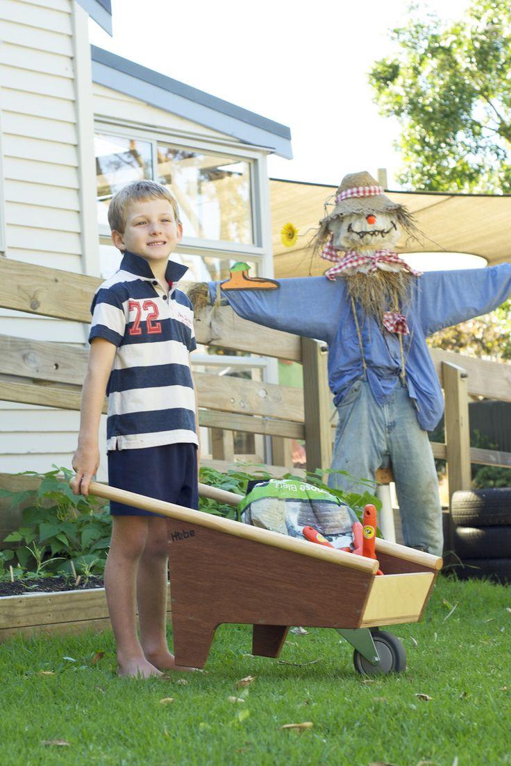 Wooden wheelbarrow - available at www.hebe.kiwi.nz