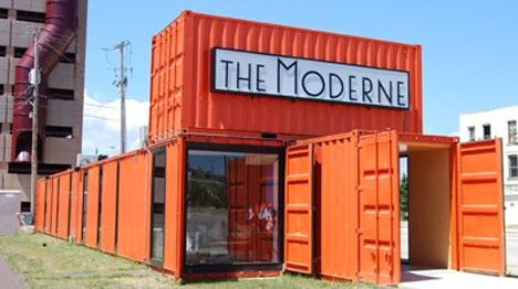 """The Moderne Offices, Milwaukee, Wisconsin    This fabulously noticeable shipping container building gives few clues as to what's housed inside its orange industrial walls. The Moderne is a proposed upscale mixed-use building in Milwaukee, and this is the sales office. If they were looking for a way to call attention to their """"modern"""" image, this was the perfect way to do it."""