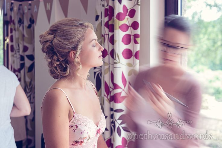 Blonde bride has wedding makeup styled by Cat Mutter makeup artist in Dorset. Photography by one thousand words wedding photographers