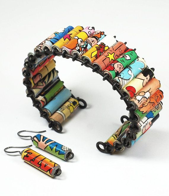 This cuff style bracelet features my hand rolled paper beads made from The Dandy Annual, a long running British comic book. The paper beads are strung on