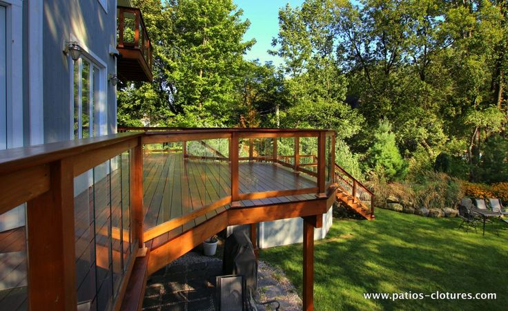 Red Cedar Railing With Tempered Glass Panels On A Balcony