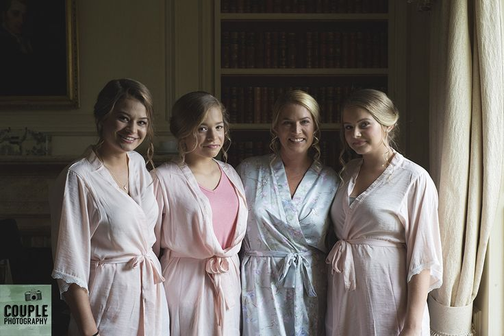 The bride and her friends getting ready for the big day. Weddings at Cliff At Lyons by Couple Photography.