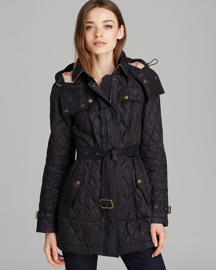 Burberry Finsbridge Long Quilted Coat | Polyamide; lining: polyester | Dry clean | Imported | Point collar with hook closure, shoulder epaulets, long sleeves with buckle cuffs, conealed front zip with