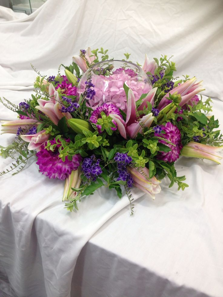Pretty in pink Beautiful oriental lilies with dahlias and hydrangea fish bowl. Imagine these at your wedding.