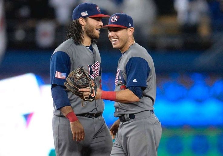 Shortstop Brandon Crawford, left, and second baseman Ian Kinsler of the United States celebrate their 2-1 victory over Japan in the semifinal of the championship round of the World Baseball Classic at Dodger Stadium.