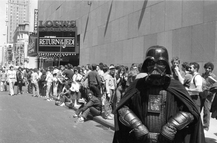 """Star Wars"""" fan Danny Fitzgerald of Staten Island in Darth Vader costume posed in front of the Loews Astor Plaza movie theater in Times Square in New York on May 25 1983 where fans lined up for the premiere of """"The Return of the Jedi."""""""