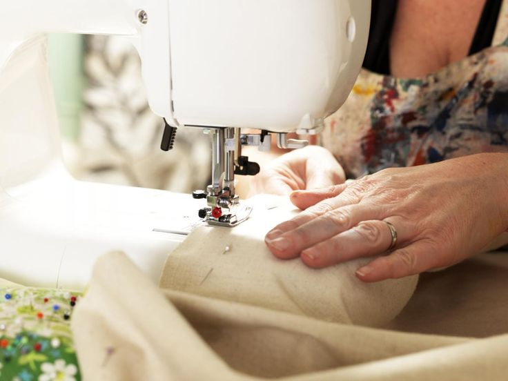 Photographed by Elke Meitzel - I like the close up of the sewing machine and the material going through it.