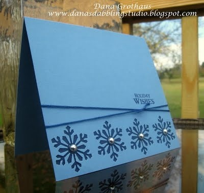 snowflake card in monochromatic blue ... clean and simple ... luv the look of negative space die cutting ... row of punched snowflakes with deeper blue showing through from underneath ...