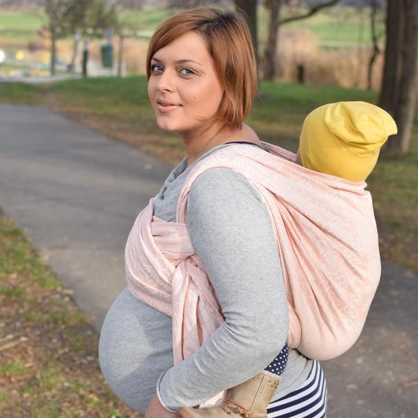 Sestrice Folk Cotton Candy 39th week pregnancy babywearing action photo
