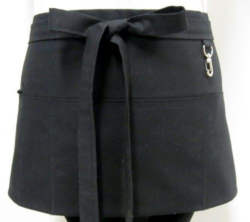 The black waitress apron measures 27 X 11.5 with 45 ties. The apron is made with Clothworks Everyday Organics cotton. Like all my aprons, there are 3 large pockets (one zippered) and a small pen pocket. The pockets and back are fully lined with a black twill cotton. The half apron also has a zippered pocket and key clasp for safe keeping your valuables. This is a perfect workhorse apron for waitresses, bartenders, craft show vendors, or just because you love black!!  There are over 50 solid…