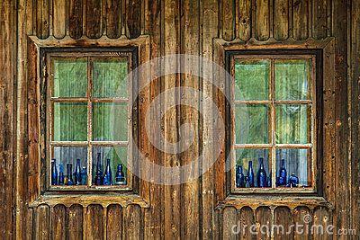 Blue color vintage bottles sitting on wooden window