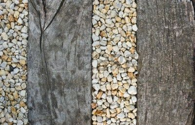 Pebbles between old wooden railway sleepers - for pathway to front door