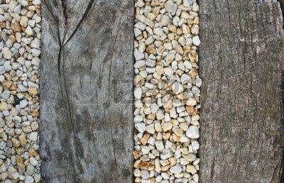 Pebbles between old wooden railway sleepers - for pathway to front door