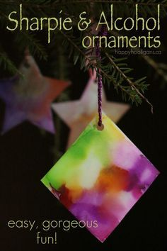 Sharpie and Alcohol Ornaments for Kids - A beautiful and fascinating technique that turns Sharpie ink into Tie-Dye! - Happy Hooligans