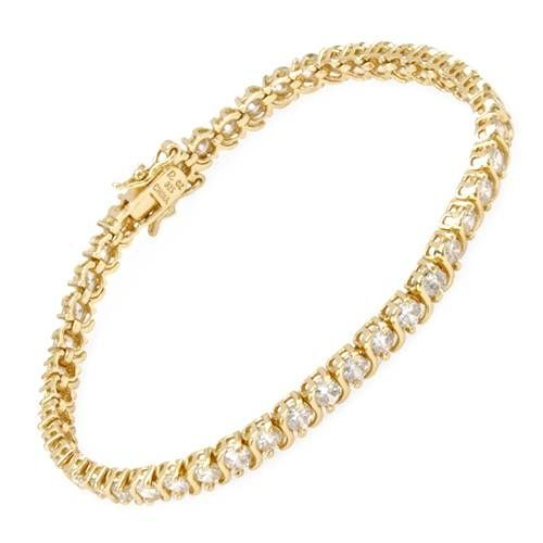 """Vakkert smykke i 925 Sterling sølv belagt med 14 karat gull. Armbåndet er dekorert med 45 hvite Cubic Zirkonia. Bredde: 4 mm. Høyde: 3 mm. Total lengde: Ca 17,8 cm (7""""). Total vekt: 10,3 g. #smykke #sølvarmbånd #armbånd #sølv #gullbelegg #14karat #zirkonia #zendesign"""