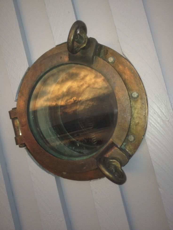 sunset in the porthole.  sandtemple at Cremorne