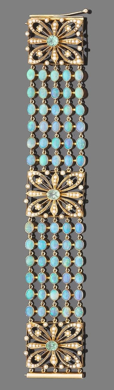 An opal, demantoid garnet and half pearl bracelet. The bracelet designed as five rows of collet-set cabochon opals, between square openwork.
