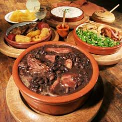 Feijoada is, essentially, Brazil's national dish - a rich black bean stew flavoured with pork bones, ribs and other meat cuts. Hearty stuff, and totally delicious. Brazil.