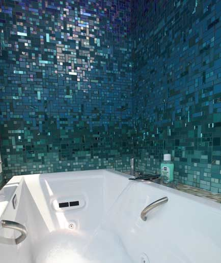 glittering blue and teal mosaic tile fade in the bathroom