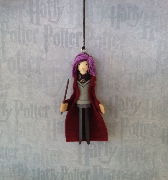 Nymphadora Tonks from Harry Potter...    Nymphadora is the wife of Remus Lupin and a member of The Order of the Phoenix.She is wearing a maroon