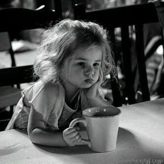 this is too cute. A grumpy little girl with a big cup of coffee. :)
