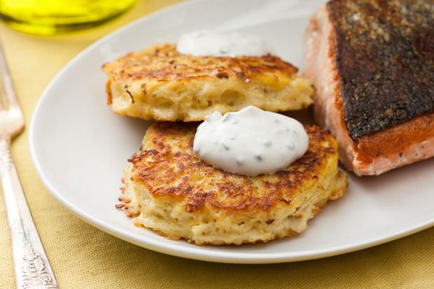 Similar to potato pancakes, this recipe mixes roasted spaghetti squash with eggs and caraway seeds, fries it into savory cakes, and tops them with sour cream.