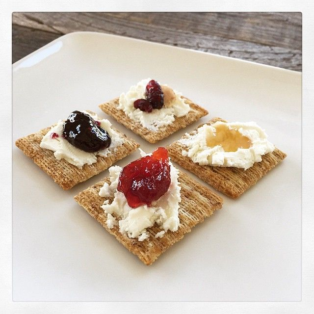 Goat cheese and cherries, honey, triple berry preserves, and cranberries and almonds. All on a Triscuit. @britandco  #madeformore #iamcreative