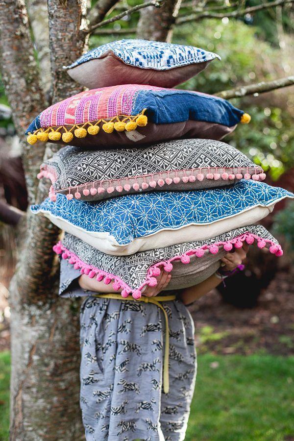 Pillows of colourful tassel laden cushions - a joy