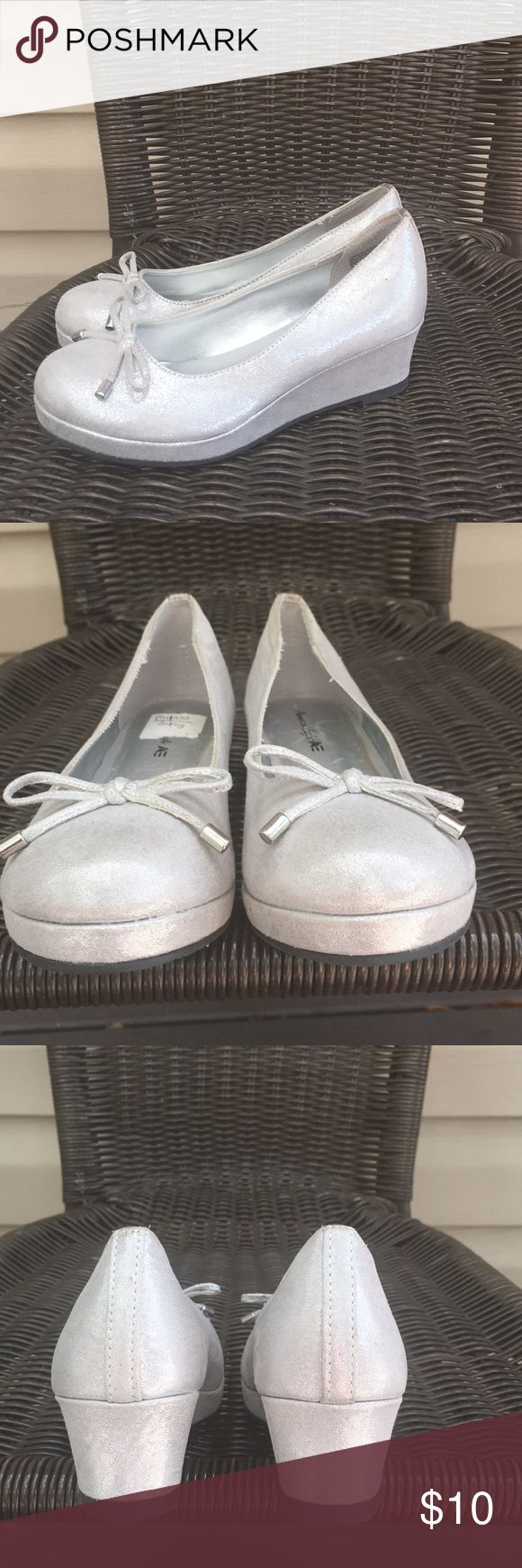 American Eagle girls silver slip on wedge shoes Lightly worn silver shoes with silver wedge heels , no scuffs, scratches or stains bow at toes. EUC American Eagle Shoes Dress Shoes