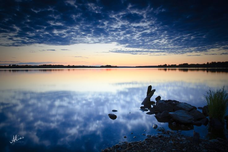Landscape photo from Siilinjärvi, Finland. Shows lake and midnight sun.