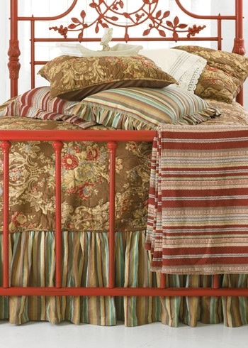 I like the mood of this floral and stripe.  painted iron bed red